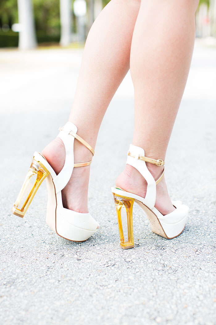 white heels with gold trim