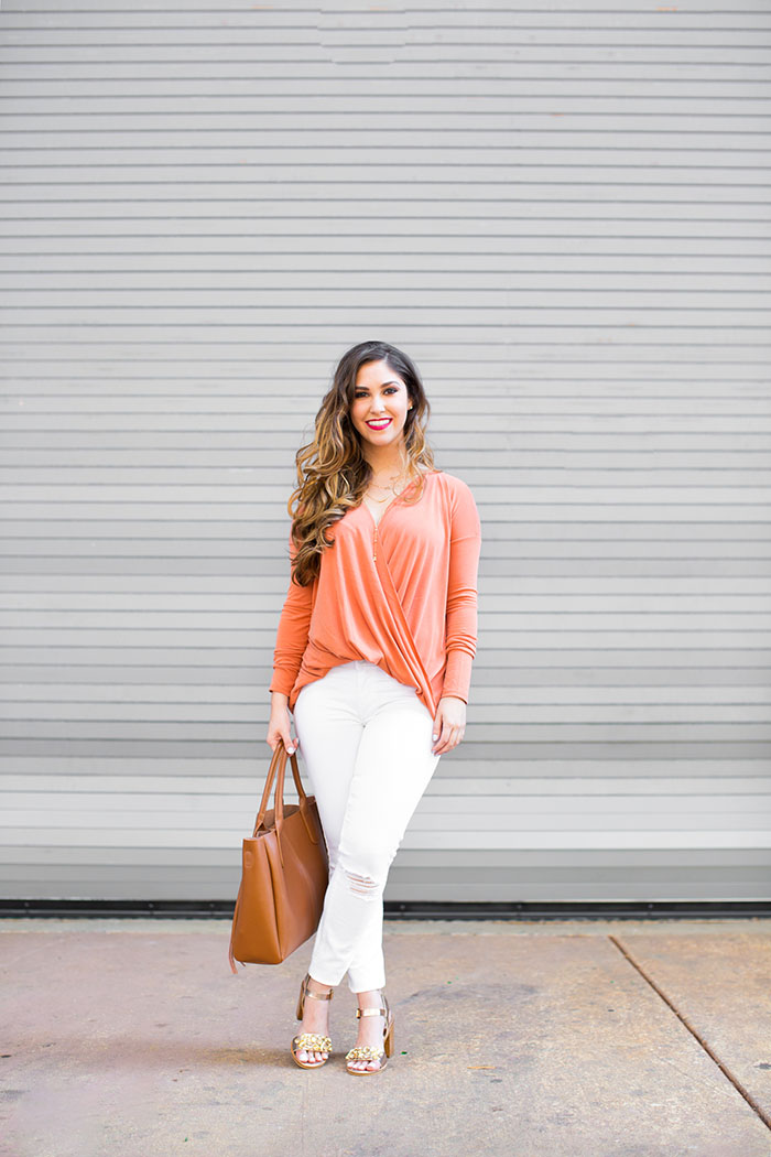 orange top and white skinny jeans