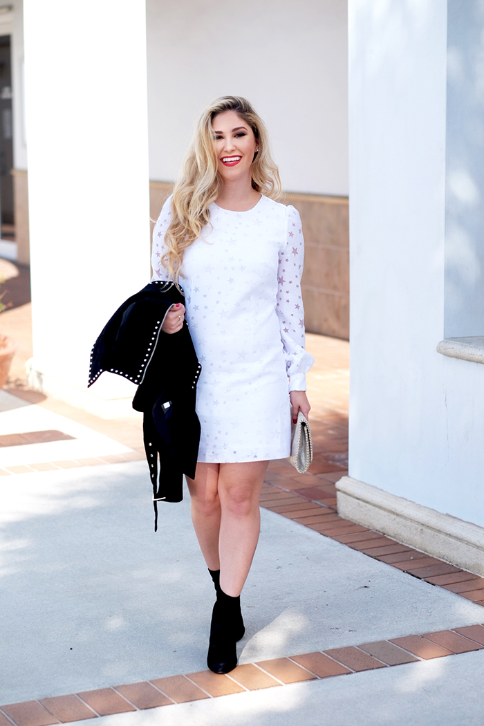 white dress and black suede jacket